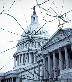Capitol dome through broken glass