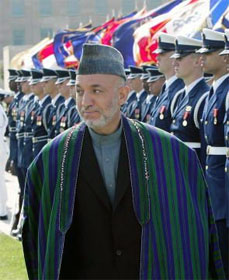 Our trustworthy Afghan partner Pres. Karzai reviews American troops, sort of