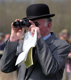 Man watching race with binoculars