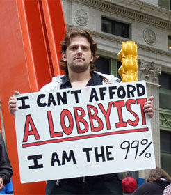 "Man with sign ""I can't afford a lobbyist. I am the 99%"""